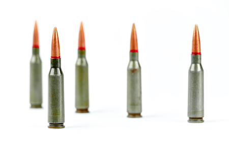 Bullets from kalasnikov AK-47 rifle ammunition closeup, isolated on white background.