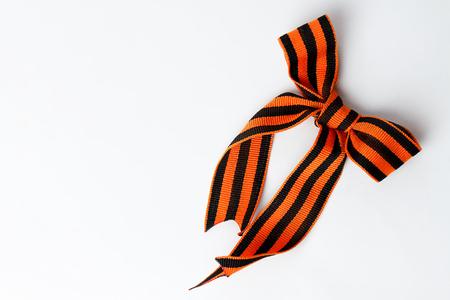 Bant of black and orange ribbons of St. George isolated on white background Stock Photo