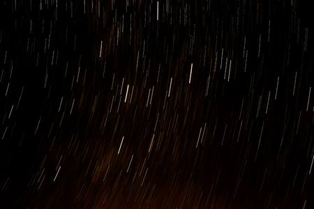 Bright tracers from stars in the night sky Stock Photo