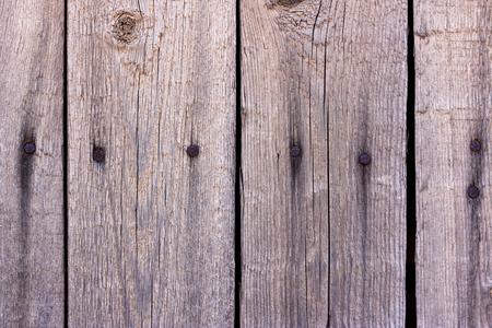 Conseil texturé d'une vieille clôture en arrière-plan