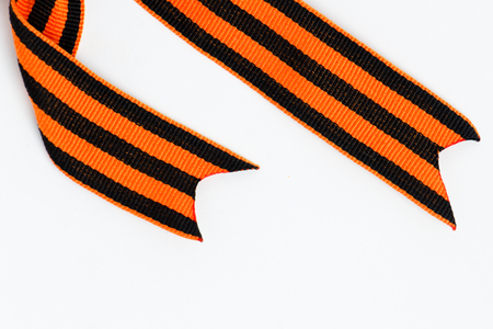 Bant of black and orange ribbons of St. George isolated on white background Stok Fotoğraf