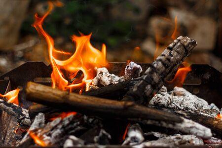 Bonfire and hot charcoal close-up top view