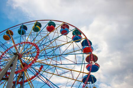 Old ferris wheel on blue sky background Stock Photo