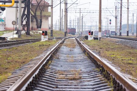 Railway station in the industrial zone rails go into the distance Stock Photo