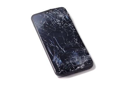 Smartphone mobile con schermo rotto isolato su bianco. Archivio Fotografico