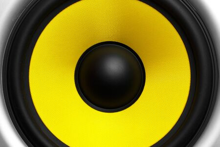 yellow speaker close-up as background