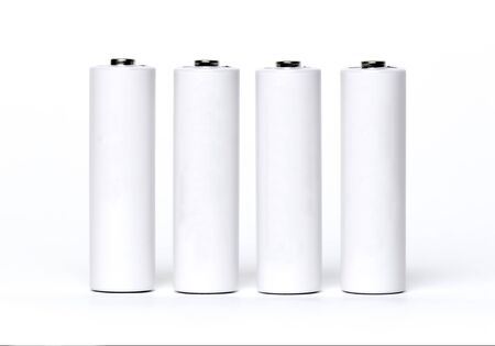 Four white batteries isolated on a white background.