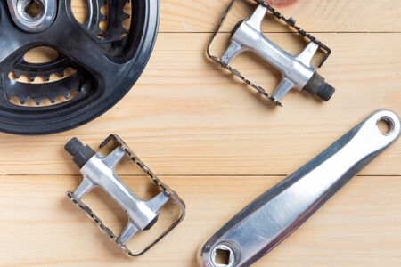 Accessories for spare parts for mountain bikes. top view on a wooden background.