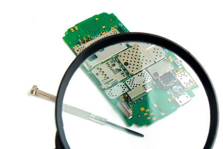 printed circuit board under a magnifying glass