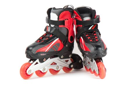 Black and red skating rollers on a white background. Фото со стока