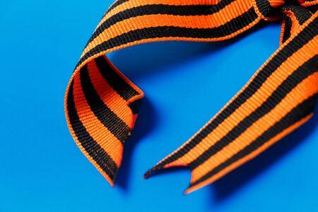 Orange black George ribbon on a blue background