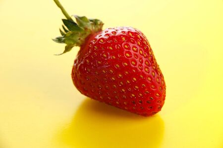 strawberries on a yellow background