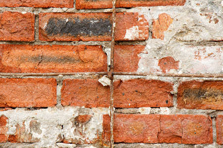 Old destroyed red brick as a background. Imagens - 151517736