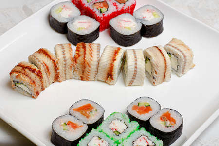 set of different types of sushi on a white plate Imagens - 153538786