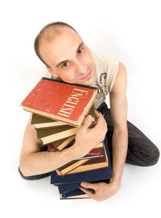 Happy young man with books. Isolated on white Stock Photo - 5318419