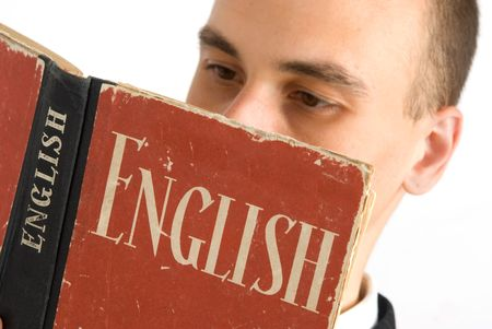 english dictionary: Man Reading Book. Focus on book. Stock Photo
