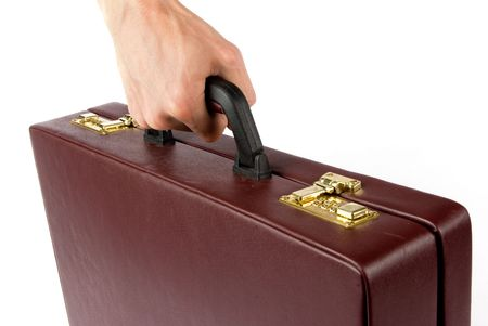 Hand holding a briefcase Stock Photo - 5339423