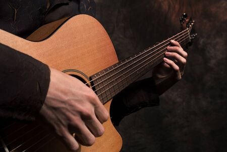 melodies: Hands with a guitar Stock Photo