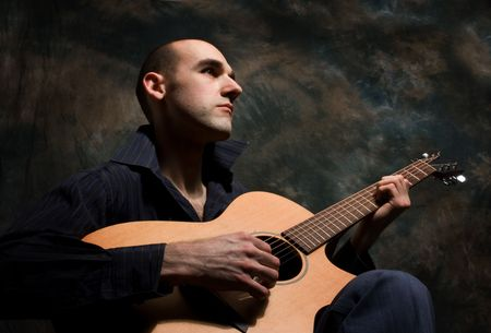 ballad: man playing acoustic guitar Stock Photo
