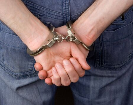 prisoner man: Hands in handcuffs Stock Photo
