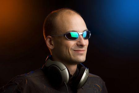 man with headphones in night club photo