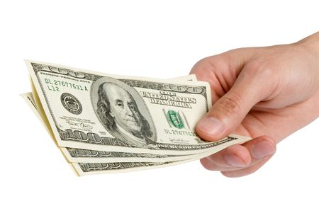 American dollars in a hand Stock Photo - 5339539