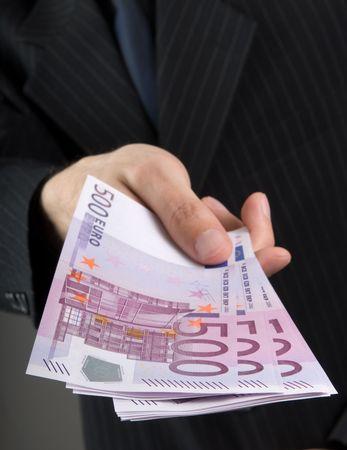 Businessman holding euros Stock Photo - 5339456