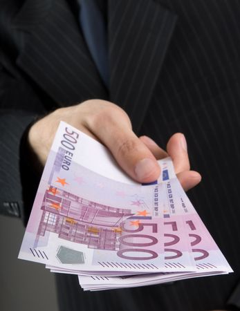 Businessman holding euros Stock Photo - 5339456