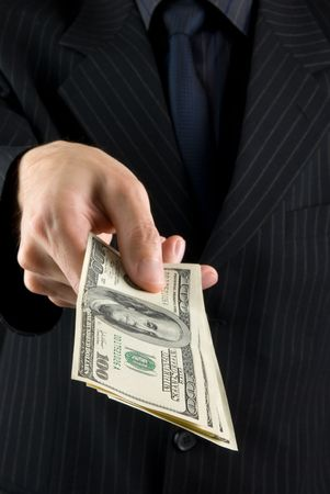 businessman holding money Stock Photo - 5339404
