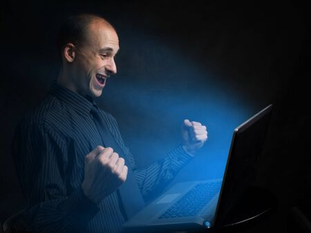 happy businessman with laptop photo