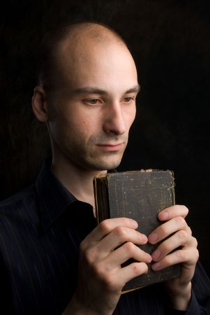 Low key portrait of young man praying Stock Photo - 5318466