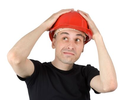 Surprised young man in a red building helmet photo