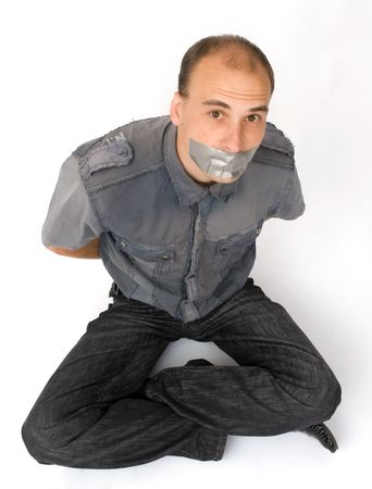 silenced: man silenced with duct tape over his mouth Stock Photo