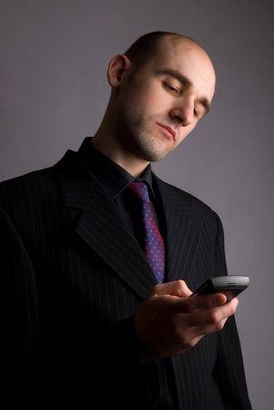 businessman waiting call: businessman calling on phone