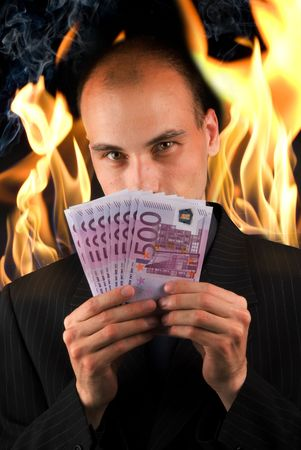 businessman holding money in hell photo