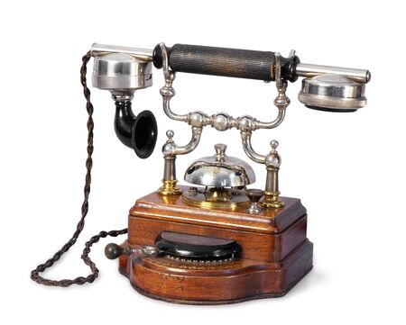 The old-fashioned retro telephone on isolated background photo