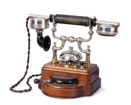 vintage telephone: The old-fashioned retro telephone on isolated background Stock Photo