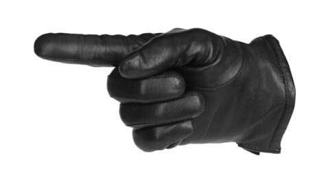 a black glove pointing, isolated on white photo