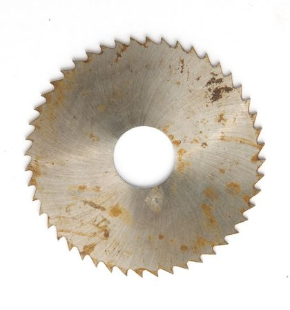 hardened: old Circular saw isolated over a white background
