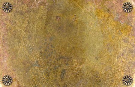 iron nail: brass metal background Stock Photo