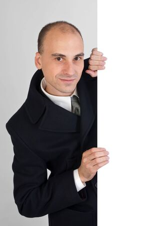 businessman holding a white board Stock Photo - 5654302