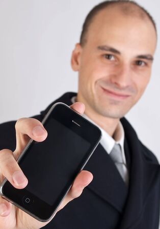 Businessman holding a mobile phone photo