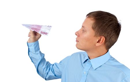 businessman throwing a airplane against white background photo