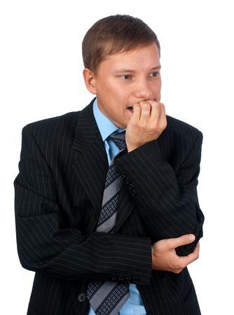 nibbling: Worried business man nibbling his fingernails Stock Photo