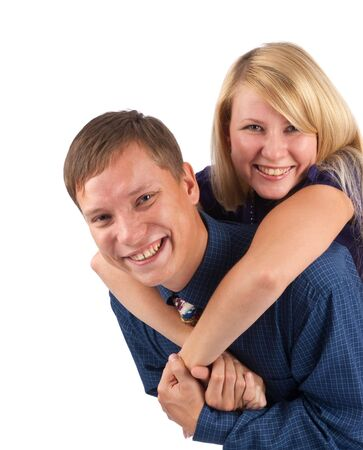 Young love couple smiling. Over white background Stock Photo - 5762374