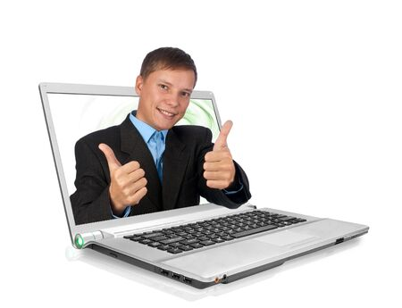 A handsome businessman with thumbs up through a laptop Stock Photo - 5833316