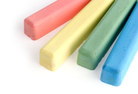 white chalks: Colorful chalks on white background