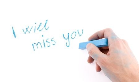 miss you: Hand with chalk writing on a white background