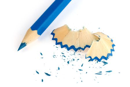 pencil sharpener: blue pencil and shavings isolated on white background
