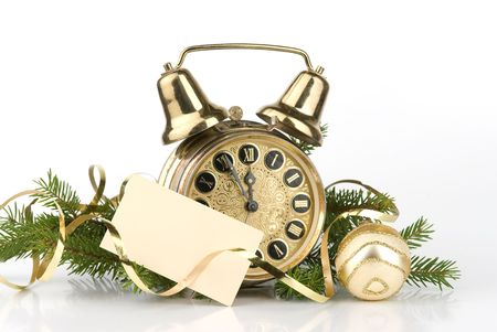New Years decoration with an antique clock and a firtree branch and a blank card for your text photo